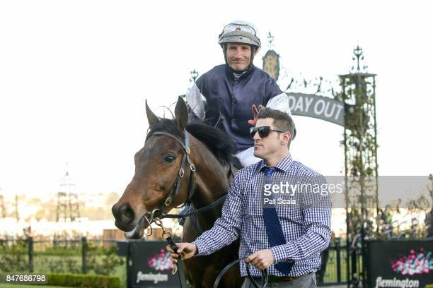 Almandin ridden by Damien Oliver returns after winning the Japan Racing Association Trophy at Flemington Racecourse on September 16 2017 in...