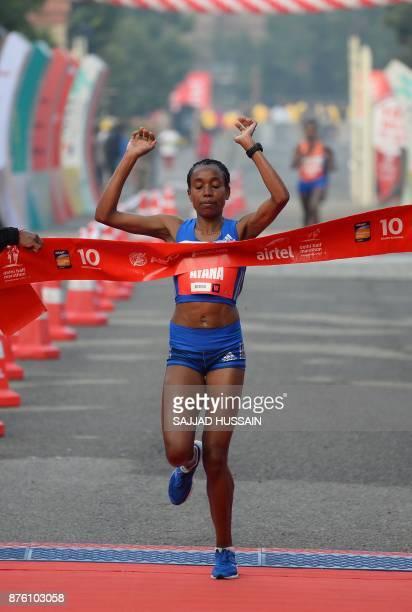 Almaz Ayana of Ethiopia runs towards the finish line to win the Airtel Delhi Half Marathon 2017 in New Delhi on November 19 2017 In the women's...