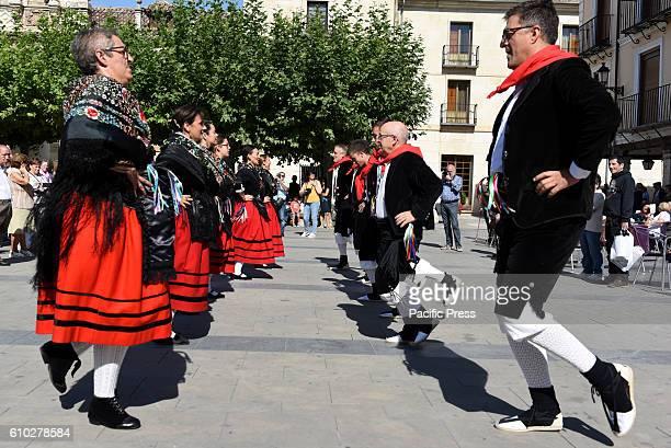 Almazán's villager pictured dancing 'El Milanazo' in the town of El Burgo de Osca northern of Spain