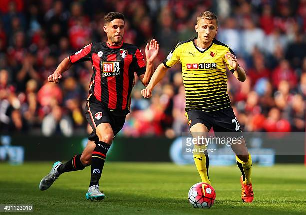 Almen Abdi of Watford and Andrew Surman of Bournemouth compete for the ball during the Barclays Premier League match between AFC Bournemouth and...