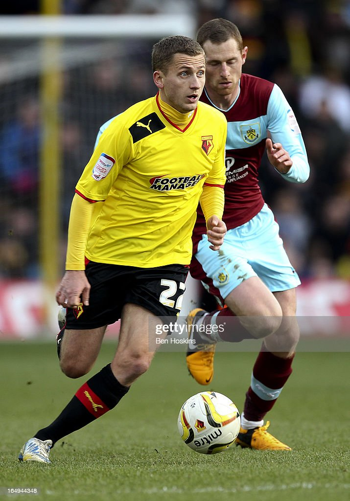 <a gi-track='captionPersonalityLinkClicked' href=/galleries/search?phrase=Almen+Abdi&family=editorial&specificpeople=2574029 ng-click='$event.stopPropagation()'>Almen Abdi</a> of Watford breaks away from Michael Duff of Burnley during the npower Championship match between Watford and Burnley at Vicarage Road on March 29, 2013 in Watford, England.