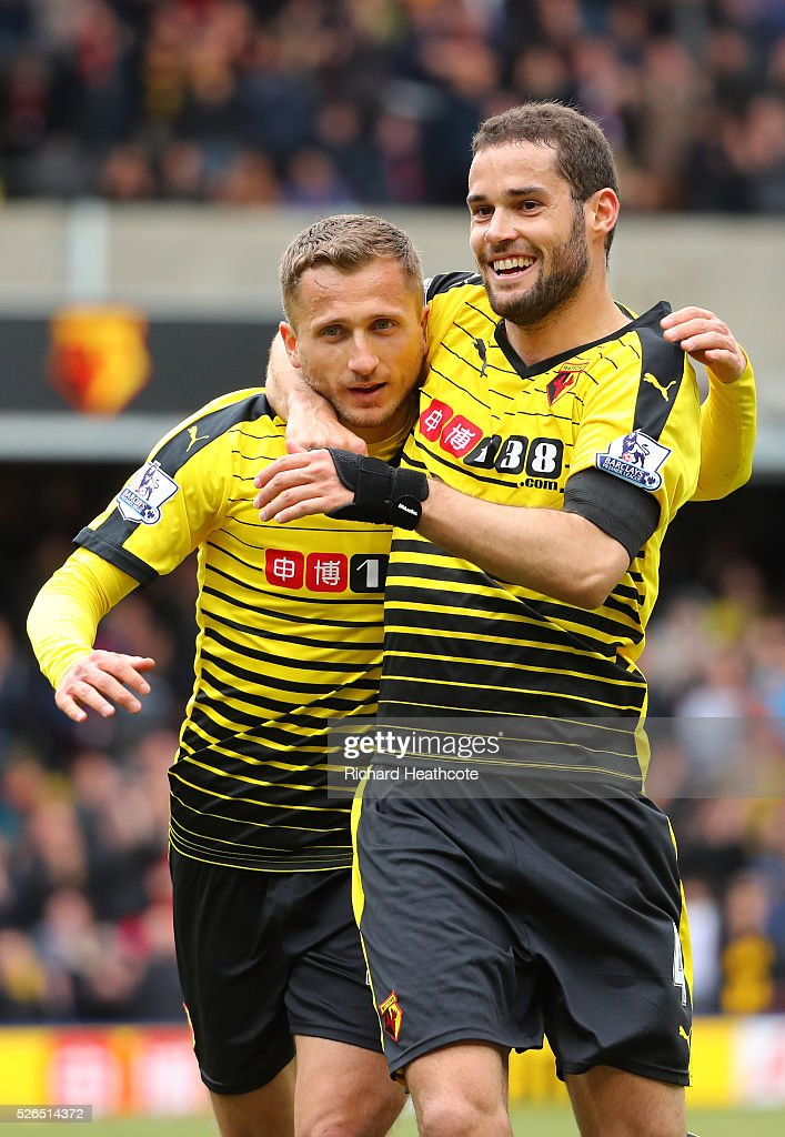 <a gi-track='captionPersonalityLinkClicked' href=/galleries/search?phrase=Almen+Abdi&family=editorial&specificpeople=2574029 ng-click='$event.stopPropagation()'>Almen Abdi</a> (L) of Watford celebrates scoring his team's first goal with his team mate Mario Suarez (R) during the Barclays Premier League match between Watford and Aston Villa at Vicarage Road on April 30, 2016 in Watford, England.