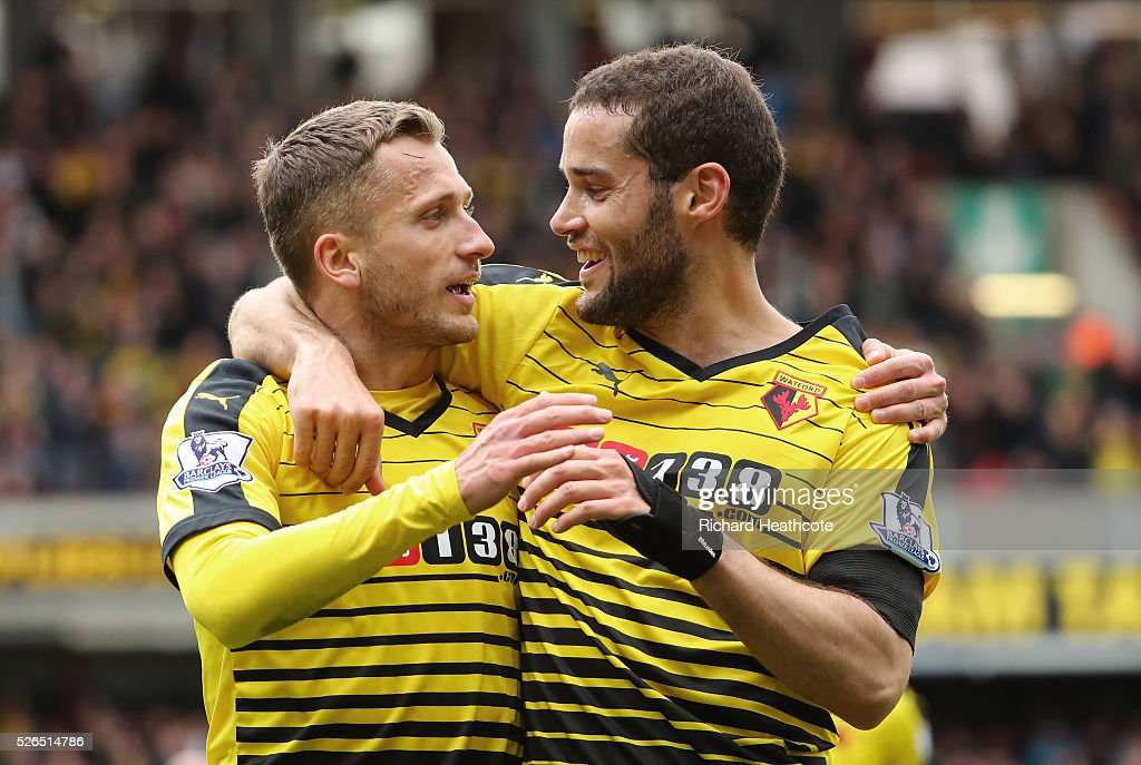 Almen Abdi (L) of Watford celebrates scoring his team's first goal with his team mate Mario Suarez (R) during the Barclays Premier League match between Watford and Aston Villa at Vicarage Road on April 30, 2016 in Watford, England.