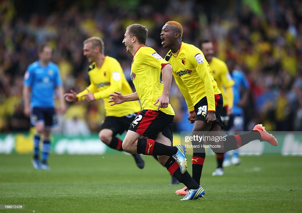 Almen Abdi of Watford celebrates scoring his team's opening goal with Nathaniel Chalobah (R) during the npower Championship match between Watford and Leeds United at Vicarage Road on May 4, 2013 in Watford, England.