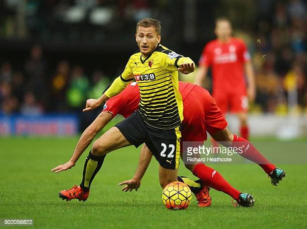 Almen Abdi of Watford evades Emre Can of Liverpool during the Barclays Premier League match between Watford and Liverpool at Vicarage Road on...