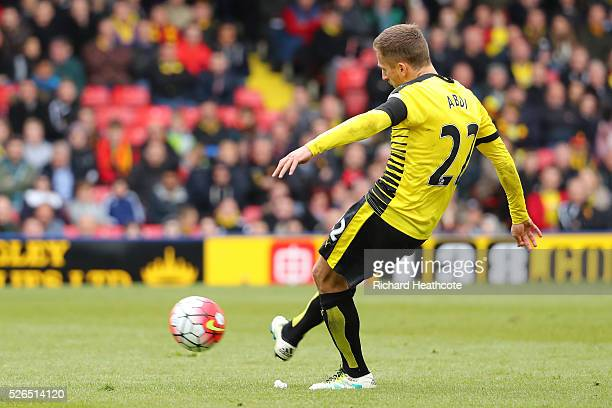 Almen Abdi of Watford scores his team's first goal from a free kick during the Barclays Premier League match between Watford and Aston Villa at...