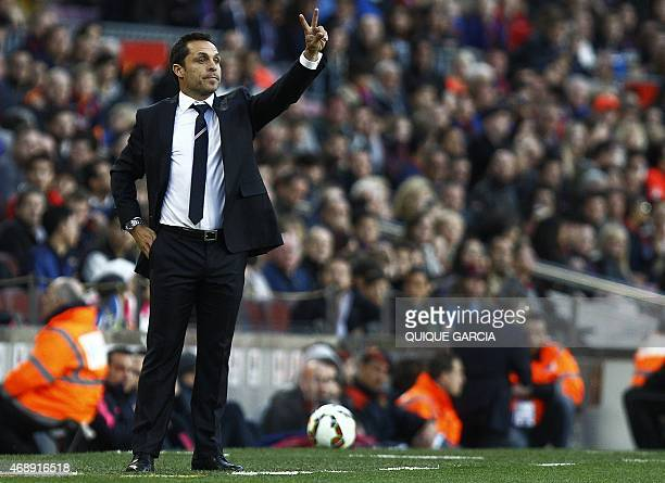 Almeria's coach Sergi Barjuan gestures from the sidelines during the Spanish league football match FC Barcelona v UD Almeria at the Camp Nou stadium...