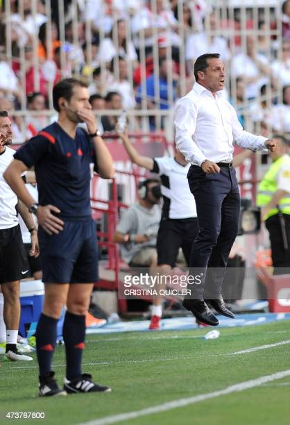 Almeria's coach Sergi BarJuan jumps in the air during the Spanish league football match Sevilla FC vs UD Almeria at the Ramon Sanchez Pizjuan stadium...