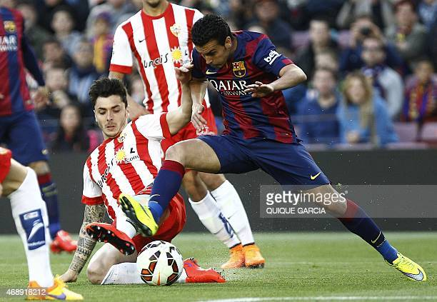 Almeria's defender Ximo Navarro vies with Barcelona's forward Pedro Rodriguez during the Spanish league football match FC Barcelona v UD Almeria at...