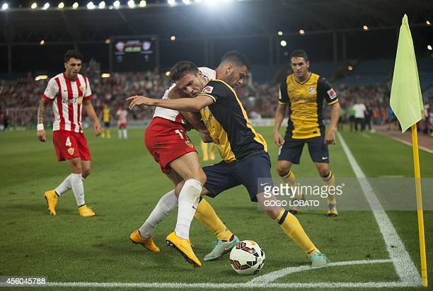 Almeria's forward Edgar Antonio Mendez Ortega vies with Atletico Madrid's Mexican forward Raul Jimenez during the Spanish league football match UD...