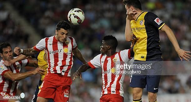 Almeria's forward Ximo Navarro heads the ball during the Spanish league football match UD Almeria vs Club Atletico de Madrid at the Juegos...