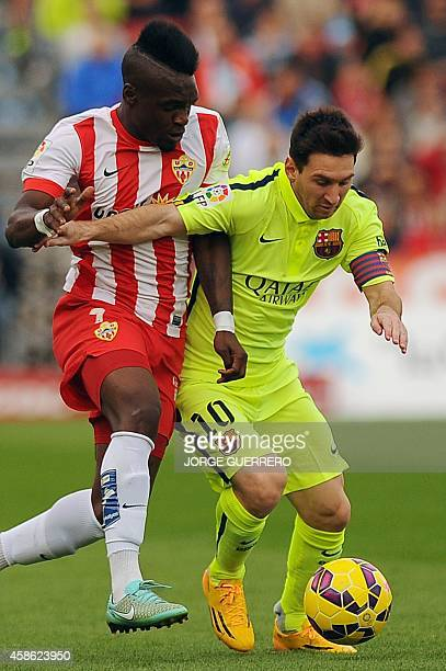 Almeria's French forward Thievy Gulvane vies for the ball with Barcelona's Argentinian forward Lionel Messi during the Spanish league football match...