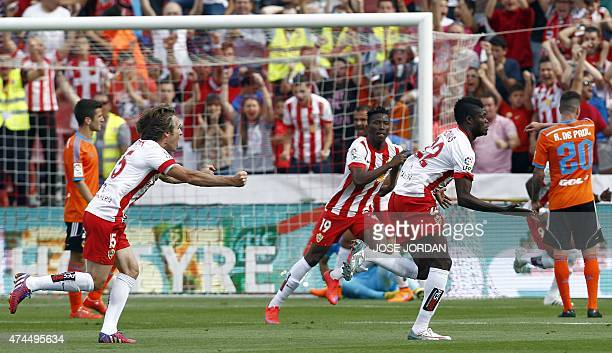 Almeria's Ghanaian midfielder Thomas Paty Partey celebrates a goal with teammatesduring the Spanish league football match UD Almeria vs Valencia CF...