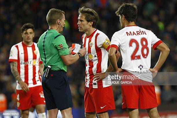 Almeria's midfielder and captain Corona argues with referee Alejandro Jose Hernandez during the Spanish league football match FC Barcelona v UD...
