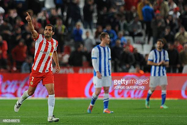 Almeria's midfielder Verza celebrates after scoring during the Spanish league football match UD Almeria vs Real Sociedad at the Juegos Mediterraneos...