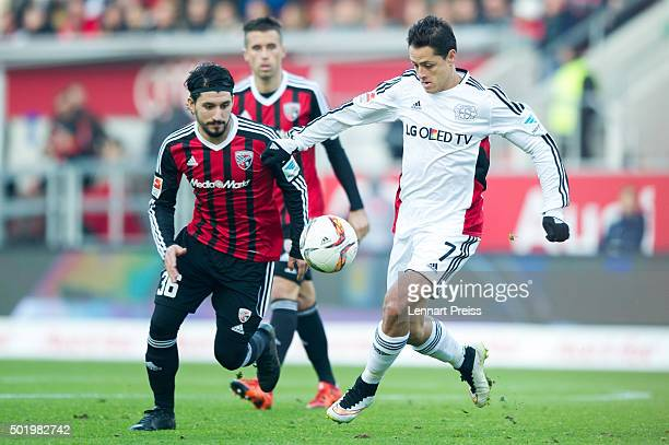 Almog Cohen of FC Ingolstadt challenges Chicharito of Bayer Leverkusen during the Bundesliga match between FC Ingolstadt and Bayer Leverkusen at Audi...