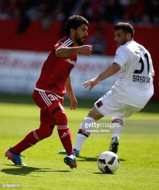 Almog Cohen of Ingolstadt and Kevin Volland of Leverkusen fight for the ball during the Bundesliga match between FC Ingolstadt 04 and Bayer 04...