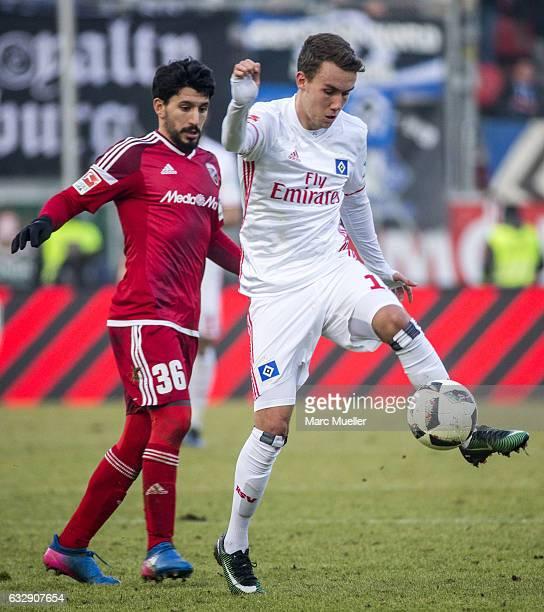Almog Cohen of Ingolstadt is challenged by GianLuca Waldschmidt of Hamburg during the Bundesliga match between FC Ingolstadt 04 and Hamburger SV at...