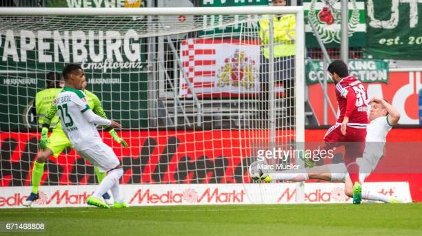 Almog Cohen of Ingolstadt takes a shot on goal during the Bundesliga match between FC Ingolstadt 04 and Werder Bremen at Audi Sportpark on April 22...