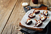 Almond and goat cheese stuffed dates. toning. selective focus