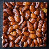 Almond brittle ob black background