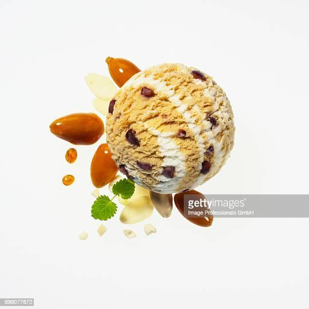 Almond ice cream with caramelised almonds, slivered almonds, whole almonds, caramel drops and lemon balm