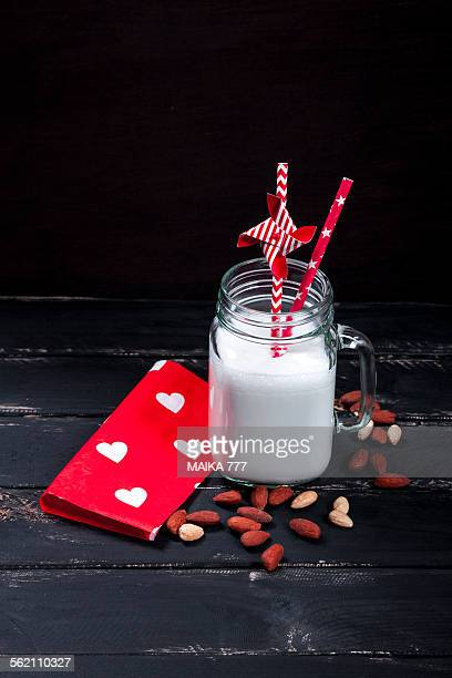Almond milk in mason jar with raw almonds
