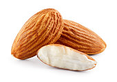 Almond. Three almond nuts isolated on white. Full depth of field.