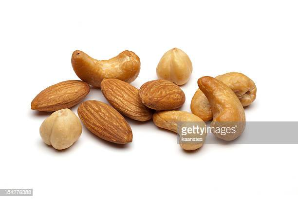 Almonds and cashew nuts on a white background