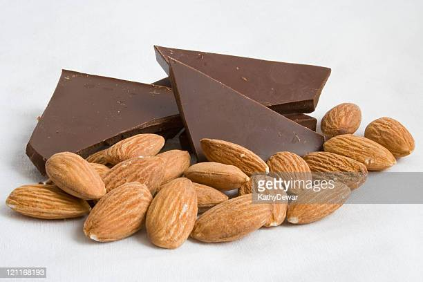 Almonds and dark chocolate pieces isolated on white