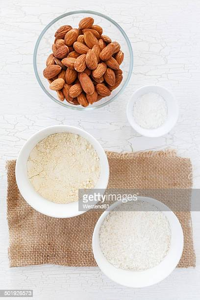 Almonds, coconut flakes and baking powder in bowls for glutenfree Carrot Coconut Banana Cupcakes