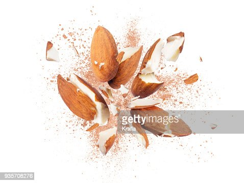 Almonds is torn to pieces close-up on white background : Stock Photo