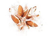 Almonds is torn to pieces close-up on white background