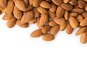 Almonds with copy space , isolated on white