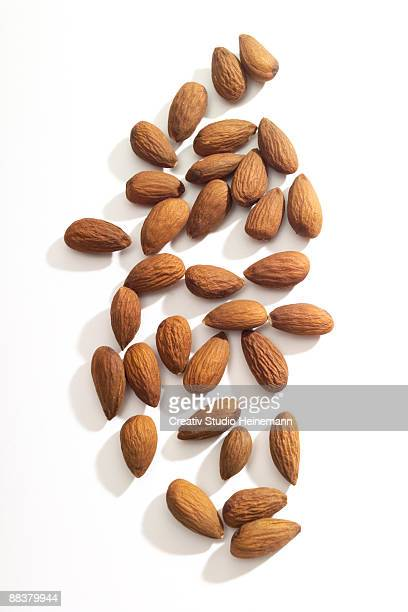 Almonds on white background, close-up