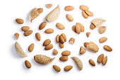 Almonds (seeds of Prunus amygdalus), singles, shelled, pieces, whole, piles. Clipping paths, shadow separated, top view