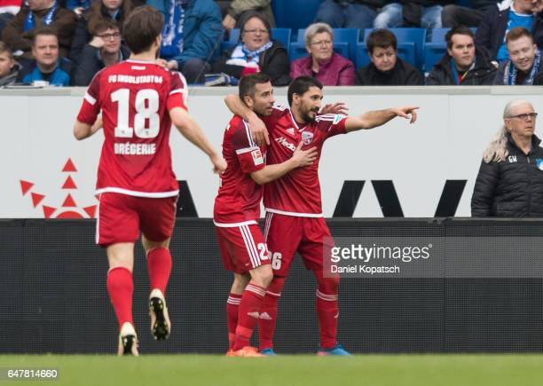 Almong Cohen of Ingolstadt celebrates his team's first goal with team mates Markus Suttner and Romain Bregerie during the Bundesliga match between...