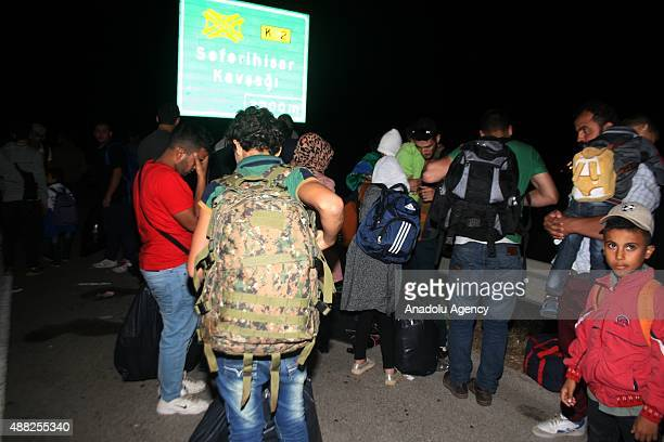 Almost 100 refugees are taken to the police department after they were crashed to police car as they prepare to pass through another country in...