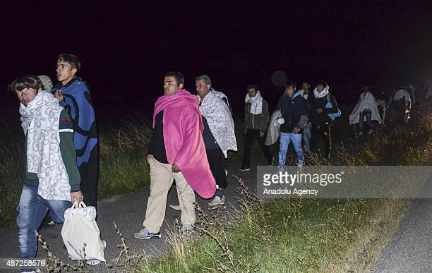 Almost 850 refugees crossed Germany Austria arrive in Rodby town nearly 160 kilometers far from Copenhagen Denmark on September 7 2015 Hundreds of...