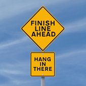 A road sign announcing the finish line just ahead