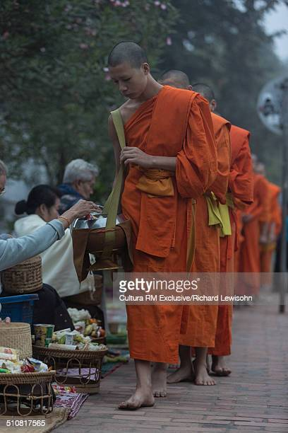 Alms giving ceremony, Sisavangvong road, Luang Prabang, Laos, Southeast Asia