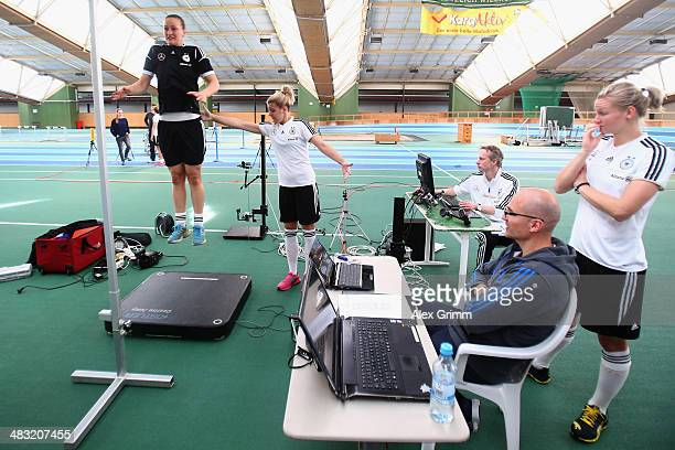 Almuth Schult jumps during a Germany women's national team performance test on April 7 2014 in Mannheim Germany