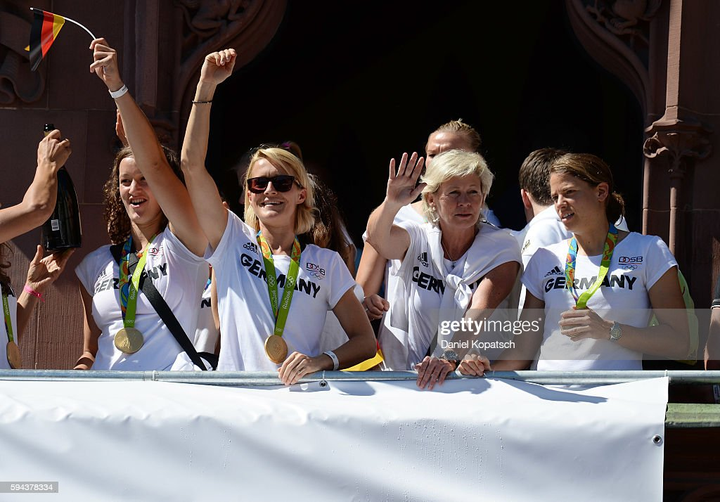 Almuth Schult Saskia Bartusiak Silvia Neid and Annike Krahn celebrate during the German Olympic Team Welcome Home Reception on August 23 2016 in...