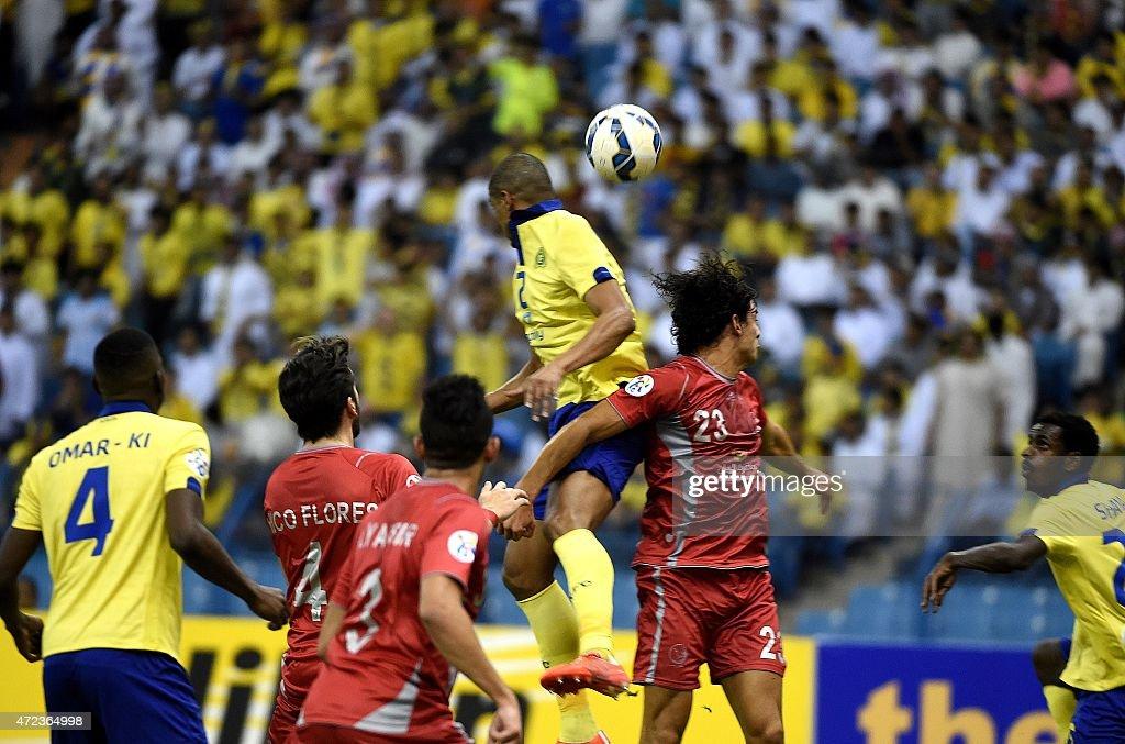 AlNassr's Mohammad Hussein vies with Lekhwiya's Sebastian Soria during the AFC Champions League football match between Saudi Arabia's AlNassr FC and...