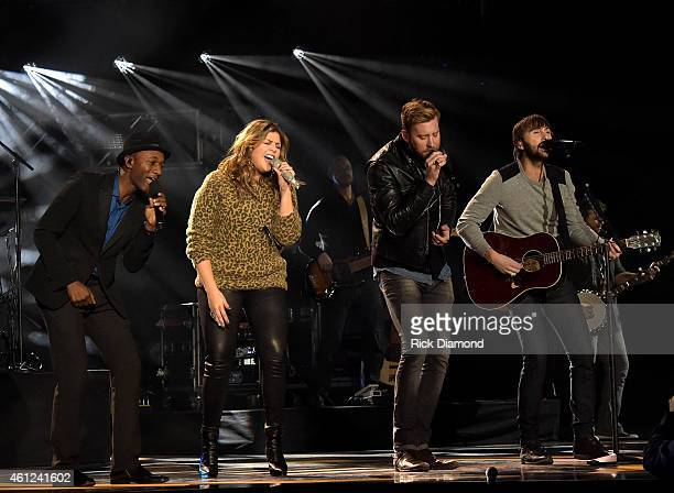 Aloe Blacc performs onstage with Hillary Scott Charles Kelley and Dave Haywood of Lady Antebellum during rehearsals for the CMT ULTIMATE KICKOFF...