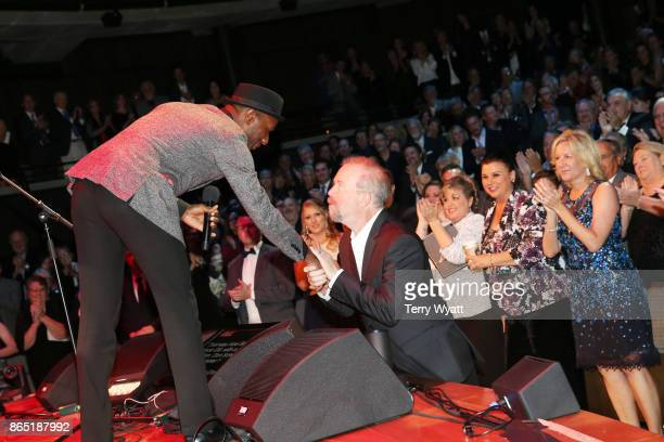 Aloe Blacc shares a moment with songwriter Don Schlitz onstage during the Country Music Hall of Fame and Museum Medallion Ceremony to celebrate 2017...
