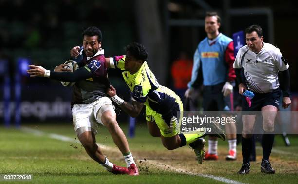 Alofa Alofa of Harlequins is tackled by Denny Solomona of Sale Sharks during the AngloWelsh Cup match between Harlequins and Sale Sharks at...