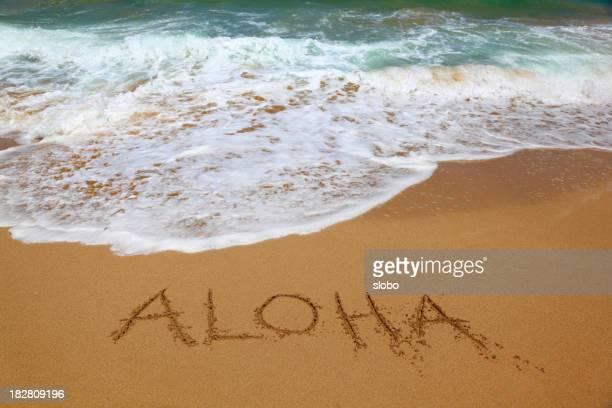 Aloha in beach sand