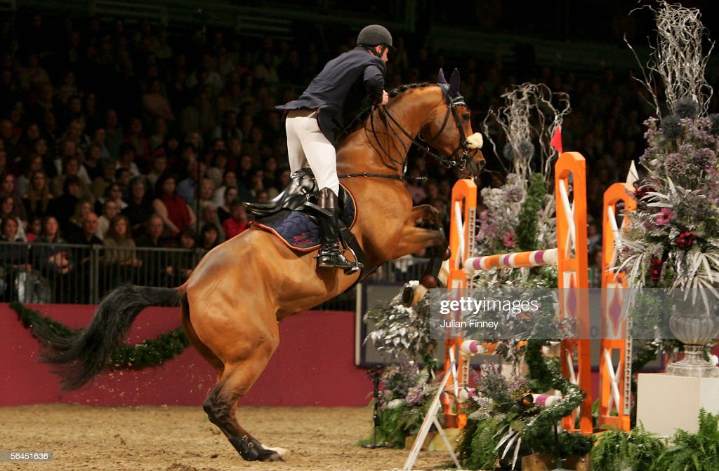 Alois PollmannSchweckhorst of Germany riding Paparazzi competes in the Ivy Stakes during the London International Horse Show at Olympia on December...