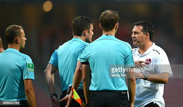 Alois Schwartz head coach of Nuernberg discusses with referee Harm Osmers after the Second Bundesliga match between 1 FC Nuernberg and 1 FC...